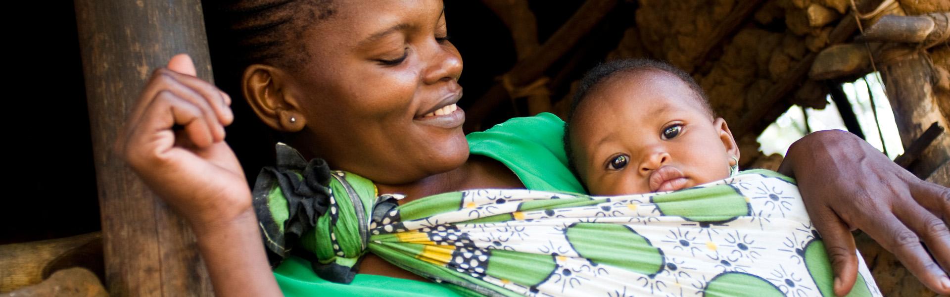 Mother and child in village at Gedi, Malindi Kenya
