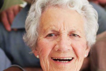Three elderly women smiling at the camera