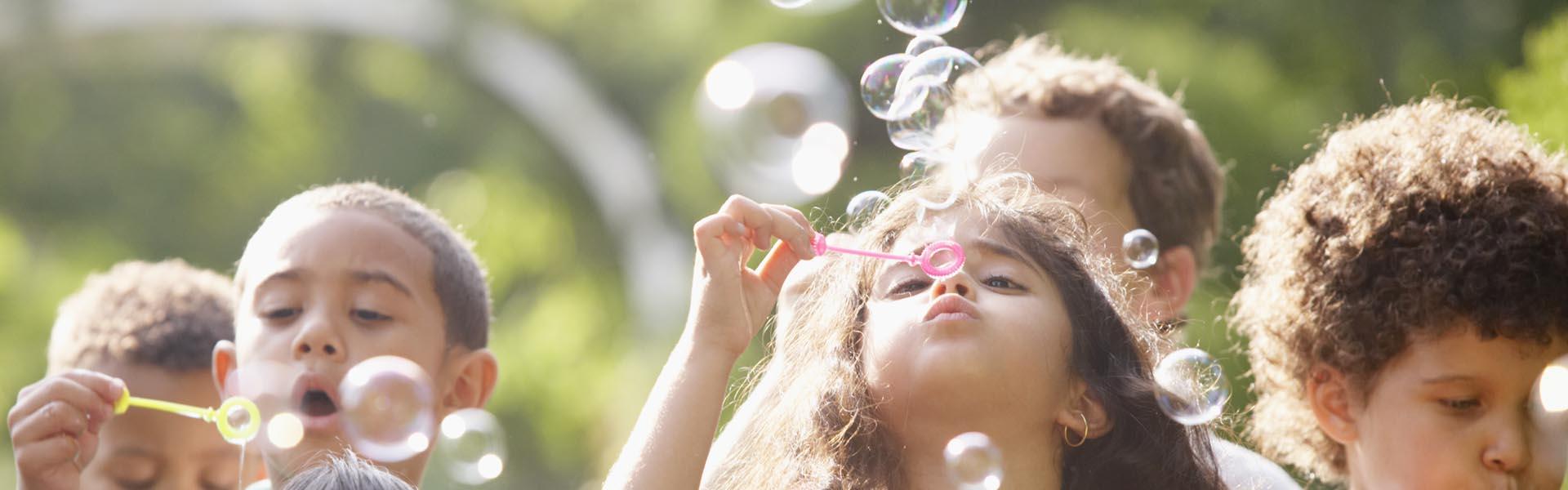Children blowing bubbles.