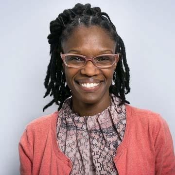 Portrait of PRB staff member Tricia McCarter.